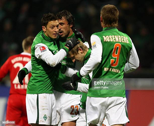 Hugo Almeida of Bremen celebrates with his team mates after scoring his team's second goal during the Bundesliga match between Werder Bremen and FC...