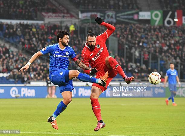 Hugo Almeida of Hannover is challenged by Aytac Sulu of Darmstadt during the Bundesliga match between Hannover 96 and SV Darmstadt 98 at HDIArena on...