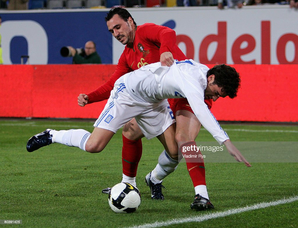 Hugo Almeida of Portugal and Georgios Seitaridis of Greece battle for the ball during the international friendly match between Portugal and Greece at...