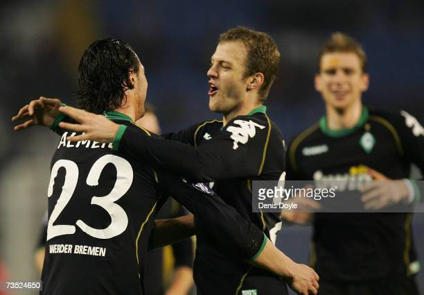 Hugo Almeida of Werder Bremen is congratulated by Daniel Jensen after scoring a goal during the UEFA Cup Round of 16 First Leg match between Celta...