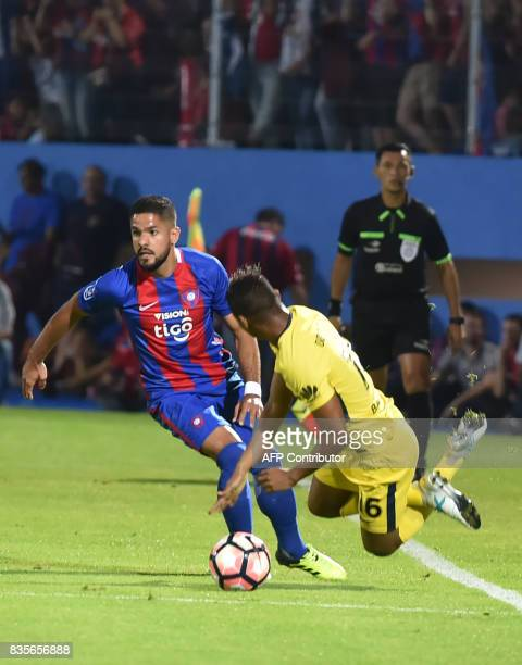 Hugo Aquino of Paraguays Cerro Porteno vies for the ball with Wilmar Barrios of Argentina's Boca Juniors during a friendly match for the inauguration...