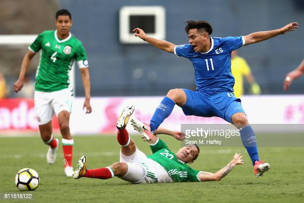 Hugo Ayala and Jesus Duenas of Mexico defend against Rodolfo Zelaya of El Salvador during the first half of a 2017 CONCACAF Gold Cup Group C match at...