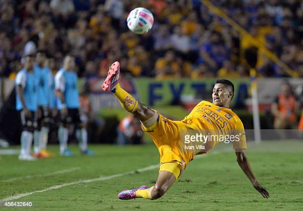 Hugo Ayala kicks the ball during a match between Tigres UANL v Santos Laguna as part of 11th round Apertura 2014 Liga MX at Universitario Stadium on...