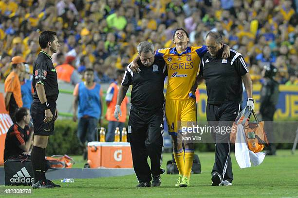 Hugo Ayala leaves the field after being injuried during a first leg final match between Tigres UANL and River Plate as part of Copa Bridgestone...
