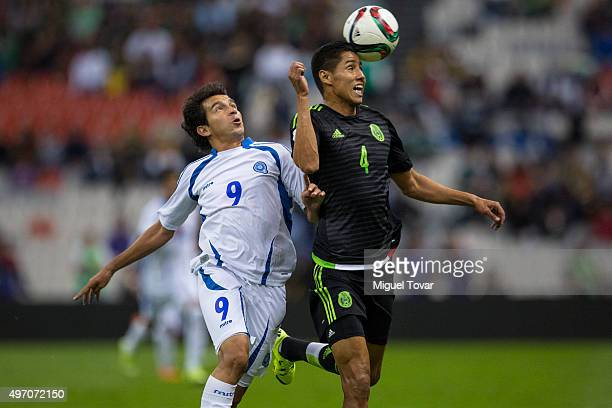 Hugo Ayala of Mexico fights for the ball with Rafael Burgos of El Salvador during the match between Mexico and El Salvador as part of the 2018 FIFA...