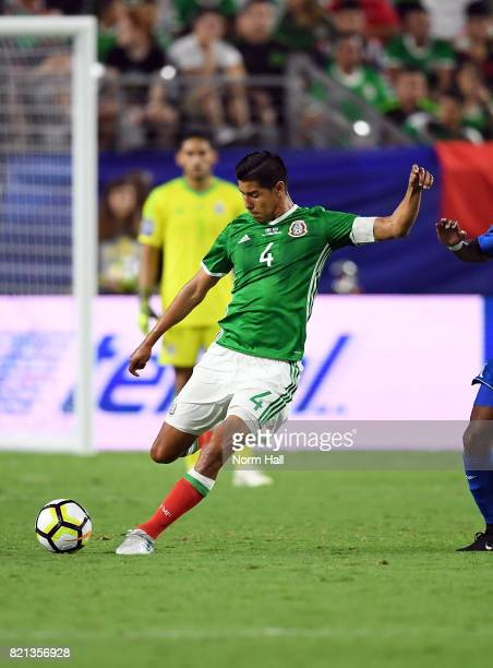 Hugo Ayala of Mexico passes the ball down field against Honduras in a quarterfinal match during the CONCACAF Gold Cup at University of Phoenix...