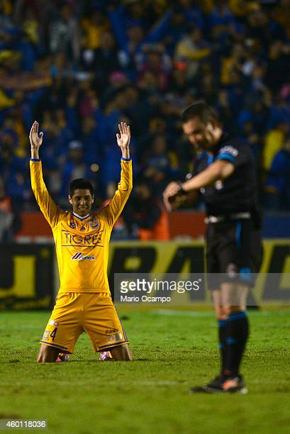 Hugo Ayala of Tigres celebrates after referee Paul Delgadillo marks the end of a semifinal second leg match between Tigres UANL and Toluca as part of...