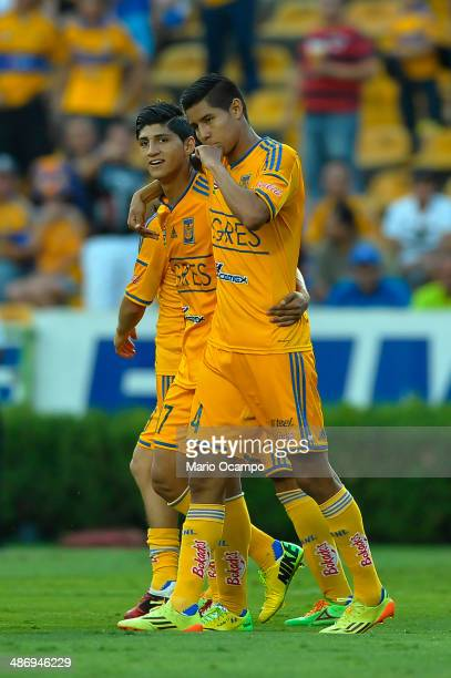 Hugo Ayala of Tigres celebrates with teammate Alan Pulido after scoring the first goal of his team during a match between Tigres UANL and Atlas as...