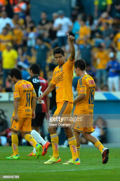 Hugo Ayala of Tigres celebrates with teammates after scoring the first goal of his team during a match between Tigres UANL and Atlas as part of 17th...