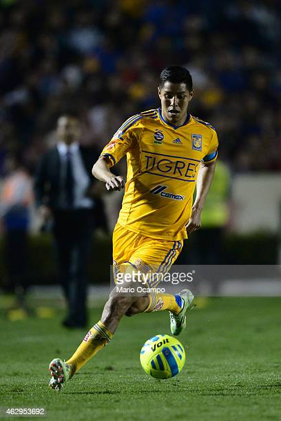 Hugo Ayala of Tigres drives the ball during a match between Tigres UANL and Puebla as part of 5th round Clausura 2015 Liga MX at Universitario...