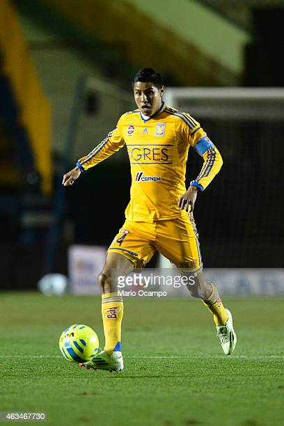 Hugo Ayala of Tigres drives the ball during a match between Tigres UANL and Morelia as part of 6th round Clausura 2015 Liga MX at Universitario...