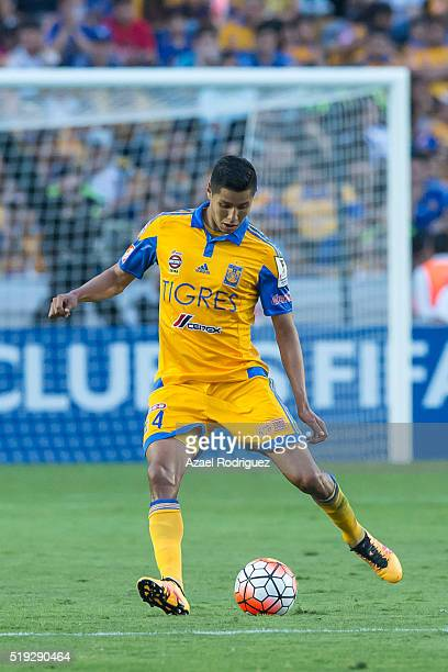 Hugo Ayala of Tigres drives the ball during the semifinals second leg match between Tigres UANL and Queretaro as part of the Concacaf Champions...