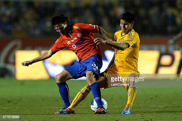 Hugo Ayala of Tigres fights for the ball with Mauro Formica of Cruz Azul during a match between Tigres UANL and Cruz Azul as part of the 10th round...