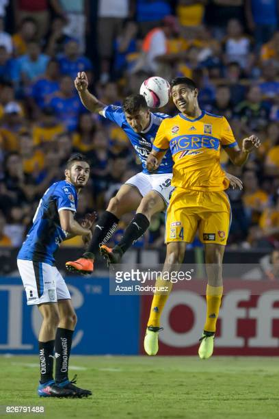 Hugo Ayala of Tigres heads the ball with Everaldo Stum of Queretaro during the 3rd round match between Tigres UANL and Puebla as part of the Torneo...