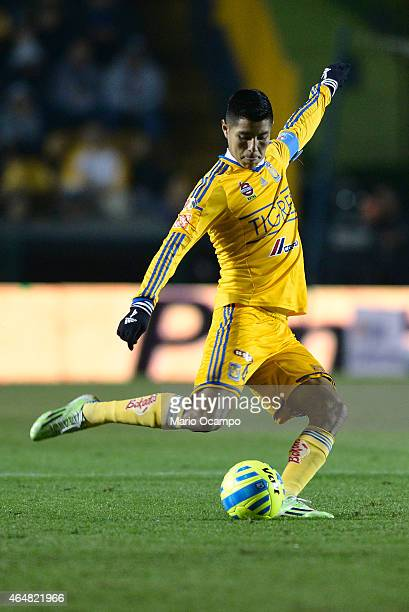 Hugo Ayala of Tigres kicks the ball during a match between Tigres UANL and Pumas UNAM as part of 8th round Clausura 2015 Liga MX at Universitario...
