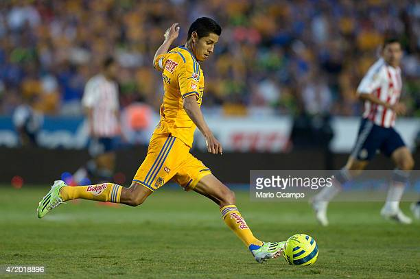 Hugo Ayala of Tigres kicks the ball during a match between Tigres UANL and Chivas as part of 16th round of Clausura 2015 Liga MX at Universitario...