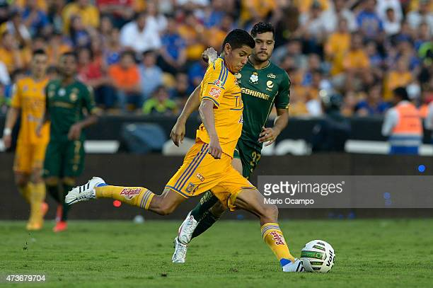 Hugo Ayala of Tigres kicks the ball during a quarterfinal second leg match between Tigres UANL and Santos Laguna as part of Clausura 2015 Liga MX at...