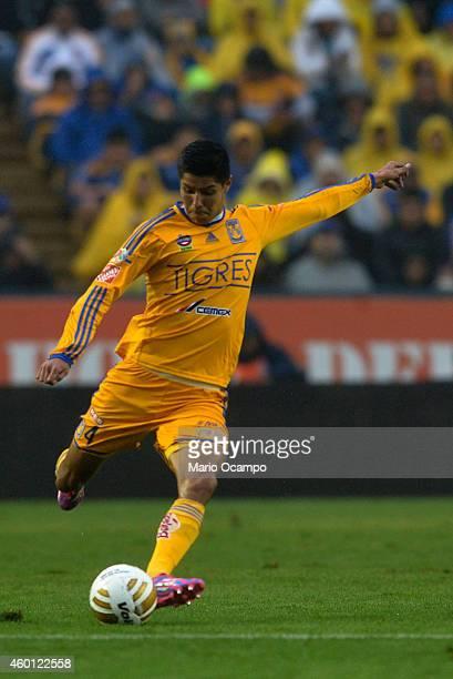 Hugo Ayala of Tigres kicks the ball during a semifinal second leg match between Tigres UANL and Toluca as part of the Apertura 2014 Liga MX at...