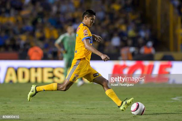 Hugo Ayala of Tigres kicks the ball during the 3rd round match between Tigres UANL and Puebla as part of the Torneo Apertura 2017 Liga MX at...