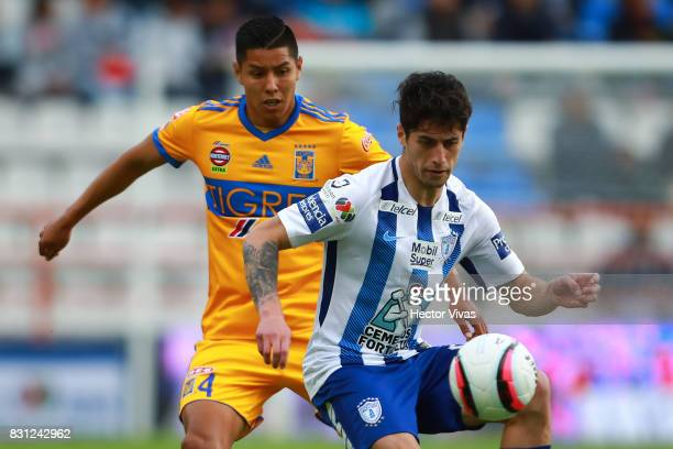 Hugo Ayala of Tigres struggles for the ball with Angelo Sagal of Pachuca during the 4th round match between Pachuca and Tigres UANL as part of the...