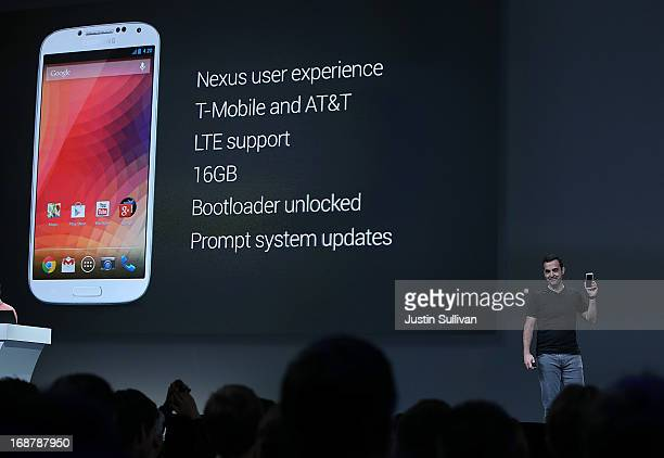 Hugo Barra Google vice president of product management for Android holds a Samsung Galaxy S4 Google Edition as he speaks during the opening keynote...