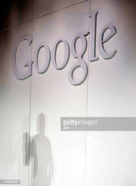 Hugo Barra Vice President Android Product Management at Google casts a shadow while displays a new Asus Nexus 7 tablet during a media event at...