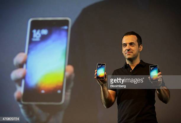 Hugo Barra vice president of Global Operations at Xiaomi Corp holds Mi 4i smartphones during a news conference in New Delhi India on Thursday April...