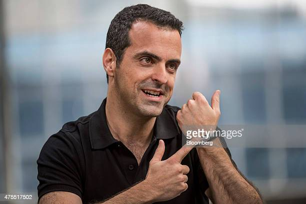Hugo Barra vice president of global operations at Xiaomi Corp points to a Xiaomi Corp Mi Band while speaking during a Bloomberg Studio 10 interview...