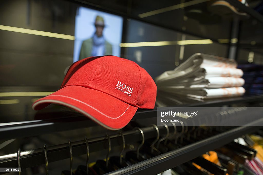 Hugo Boss logo sits on a cap displayed for sale inside Hugo Boss AG's store on Regent Street in London, U.K. on Tuesday, May 21, 2013. Hugo Boss AG reiterated its earnings forecast for the year after the German luxury-clothing maker said its retail business increased sales by 14 percent in the first quarter as it opened more outlets. Photgrapher: Simon Dawson/Bloomberg via Getty Images