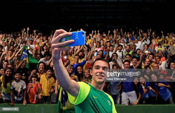 Hugo Calderano of Brazil takes a selfie with fans after winning a Men's Singles second round match against Par Gerell of Sweden on Day 2 of the Rio...