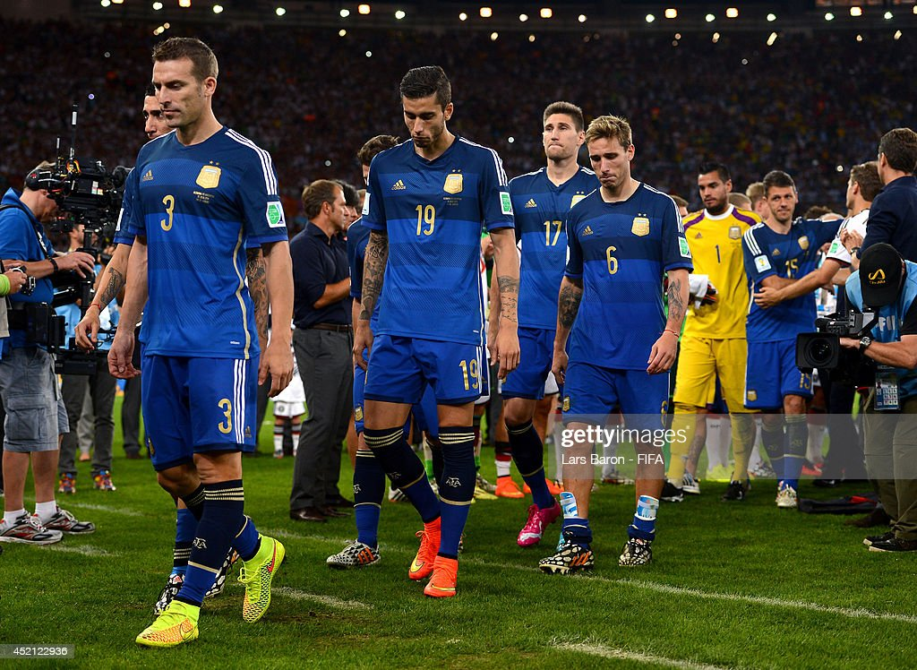 Hugo Campagnaro (1st L) and players of Argentina react after the 2014 FIFA World Cup Brazil Final match between Germany and Argentina at Maracana on July 13, 2014 in Rio de Janeiro, Brazil.