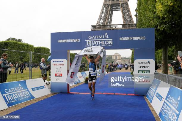 Hugo Celerier of France crosses the finish line of the 2017 edition of the Paris triathlon on July 2 2017 in Paris An unprecedented course located...