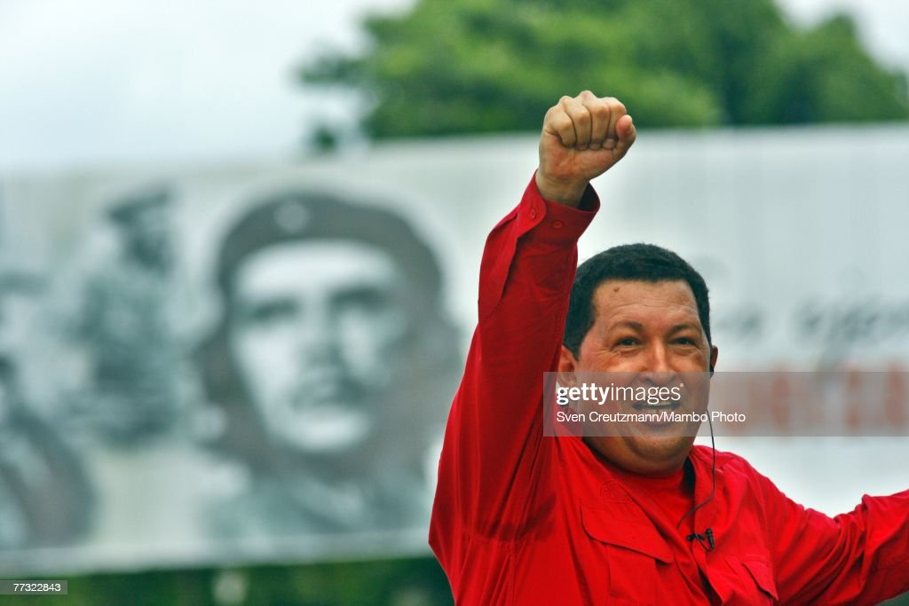 Hugo Chavez, President of Venezuela, gestures during his 'Alo Presidente' program in front of an image of Che Guevara October 14, 2007 in Santa Clara, Cuba. Chavez will transmit his weekly 'Alo Presidente' program from the Che Guevara Monument.
