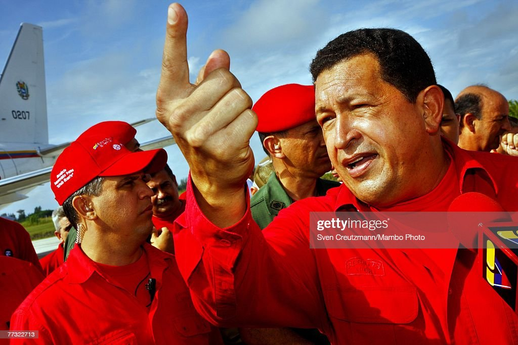 <a gi-track='captionPersonalityLinkClicked' href=/galleries/search?phrase=Hugo+Chavez&family=editorial&specificpeople=171094 ng-click='$event.stopPropagation()'>Hugo Chavez</a>, President of Venezuela, talks to the press as he arrives at the Santa Clara airport October 14, 2007 in Santa Clara, Cuba. Chavez will transmit his weekly 'Alo Presidente' program from the Che Guevara Monument.