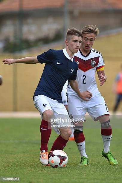 Hugo Coldefy of France is challenged by Robin Hack of Germany during the International Friendly match between U16 France and U16 Germany at Stade...