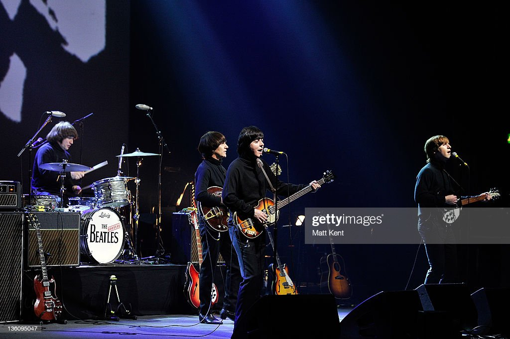Hugo Degenhardt (Ringo Star), Andre Barreau (George Harrison), David Catlin-Birch (Paul McCartney) and Adam Hastings (John Lennon) of The Bootleg Beatles perform on stage at HMV Hammersmith Apollo on December 19, 2011 in London, United Kingdom.