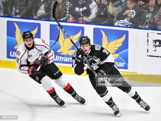 Hugo Despres of the RouynNoranda Huskies and Alexandre Alain of the BlainvilleBoisbriand Armada skate against each other during the QMJHL game at...