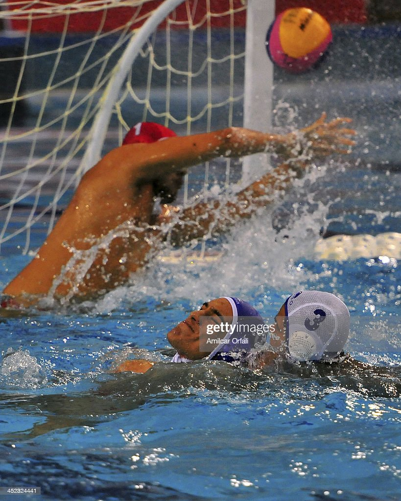 Hugo Enrique Velasquez of Venezuela fights for the ball with Diego Alonso Guevara of Peru during a match between Peru and Venezuela as part of the XVII Bolivarian Games Trujillo 2013 at Campo de Marte on November 27, 2013 in Lima, Peru.