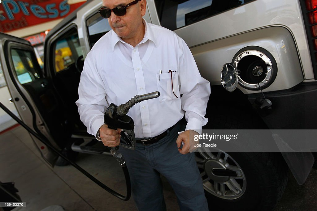 Hugo Hernandez fills his vehicle up with gas in a county where some grades of gasoline have already surpassed the $4 mark on February 21, 2012 in Miami, Florida. Fears of $5 per gallon gasoline are being heard as summer approaches and some feel that would hurt the economy just as an economic recovery appears to be getting traction.