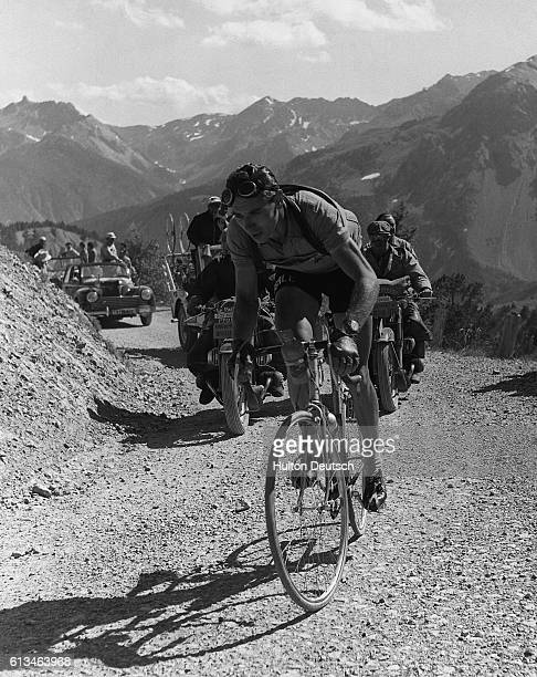 Hugo Koblet of Switzerland negotiates a bend on an alpine road during a stage of the 1951 Tour de France which he went on to win