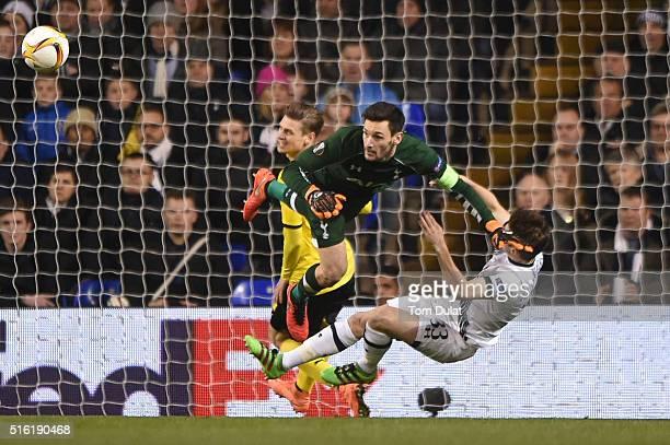 Hugo Lloris and Ben Davies of Tottenham Hotspur collide during the UEFA Europa League round of 16 second leg match between Tottenham Hotspur and...