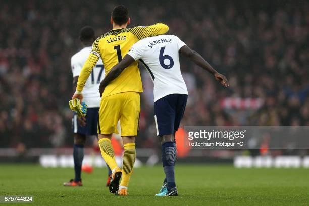 Hugo Lloris and Davinson Sanchez of Tottenham Hotspur show dejction after the Premier League match between Arsenal and Tottenham Hotspur at Emirates...