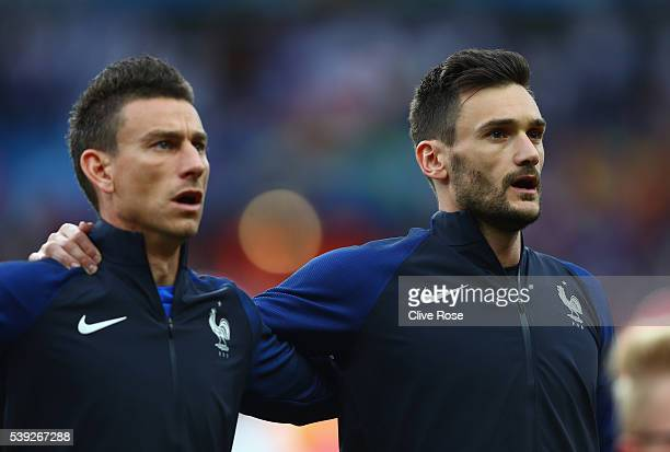 Hugo Lloris and Laurent Koscielny of France line up for the national anthem prior to the UEFA Euro 2016 Group A match between France and Romania at...