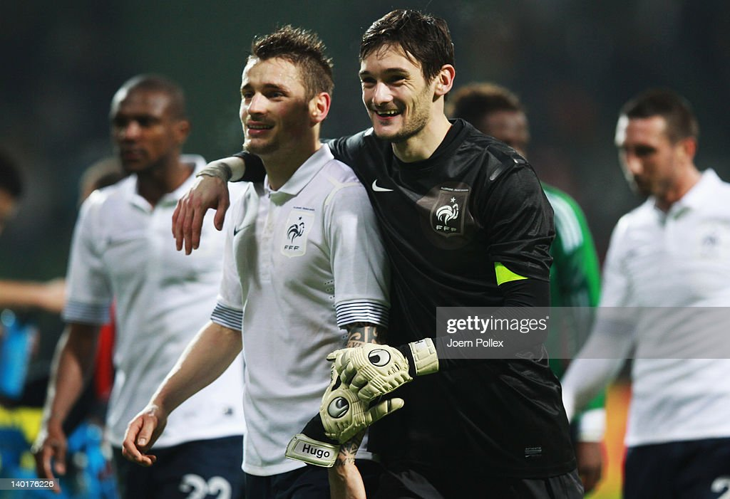Hugo lloris and Mathieu Debuchy of France celebrate after the International friendly match between Germany and France at Weser Stadium on February 29...