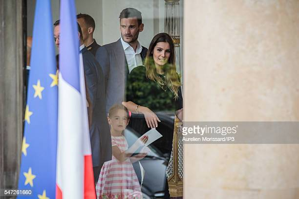 Hugo Lloris Captain of France s Soccer Team in his suit arrive with his wife Marine Lloris to meet French President Francois Hollande after his team...