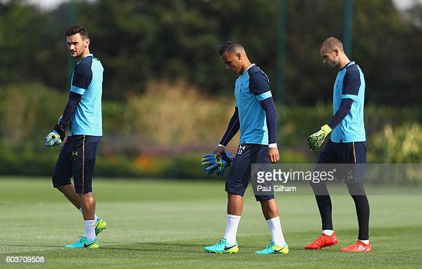Hugo Lloris Michel Vorm and Pau Lopez of Tottenham Hotspur walk out prior to the Tottenham Hotspur training session at Tottenham Hotspur training...