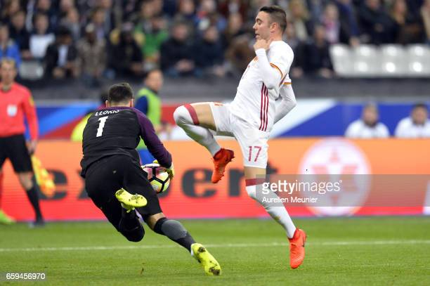 Hugo Lloris of France and Iago Aspas of Spain compete for the ball during the international friendly match between France and Spain at Stade de...