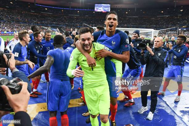 Hugo Lloris of France and Raphael Varane of France celebrate their team's qualification after the Fifa 2018 World Cup qualifying match between France...