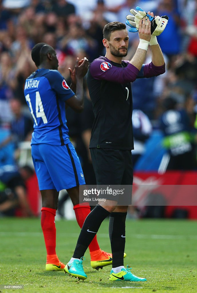 <a gi-track='captionPersonalityLinkClicked' href=/galleries/search?phrase=Hugo+Lloris&family=editorial&specificpeople=2501893 ng-click='$event.stopPropagation()'>Hugo Lloris</a> (R) of France applauds after his team's 2-1 win in the UEFA EURO 2016 round of 16 match between France and Republic of Ireland at Stade des Lumieres on June 26, 2016 in Lyon, France.