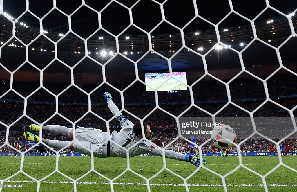 Hugo Lloris of France dives in vain as Eder of Portugal scores the opening goal during the UEFA EURO 2016 Final match between Portugal and France at...
